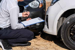 Insurance Agent Inspecting assessed Damaged Car checking and sig